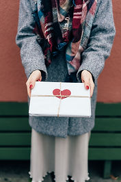 vertical-photo-close-up-of-a-gift-with-a-red-heart-ECTR7G8.JPG