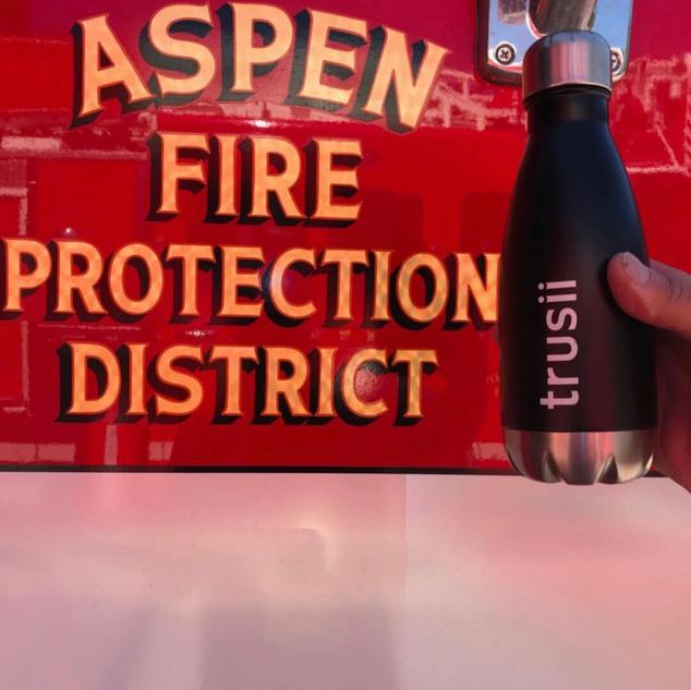 trusii, trusii water bottle in front of firetruck