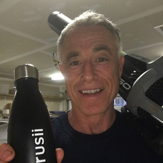 trusii, Smiling healthy older man with trusii water bottle
