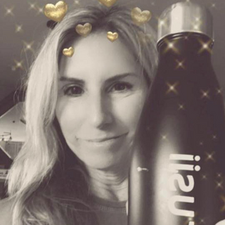 trusii, trusii water bottle with smiling woman