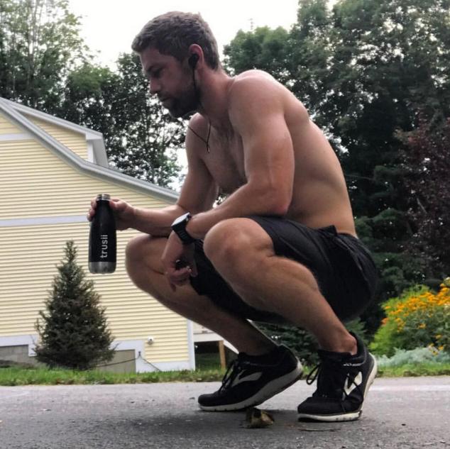 trusii, trusii man drinking water after a run