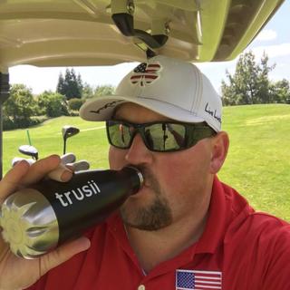 trusii, man drinking trusii on golf course