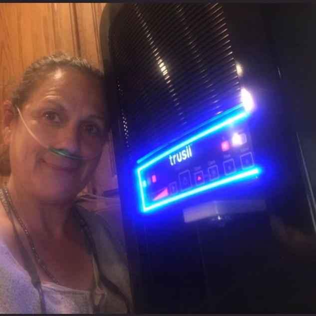 trusii, Older woman using trusii hydrogen inhalation on EliteX