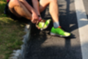 sports injury marathon runner roadside.j