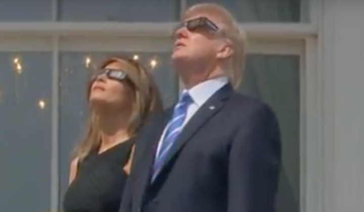 Watch this dunce stare straight into the sun without his protective glasses