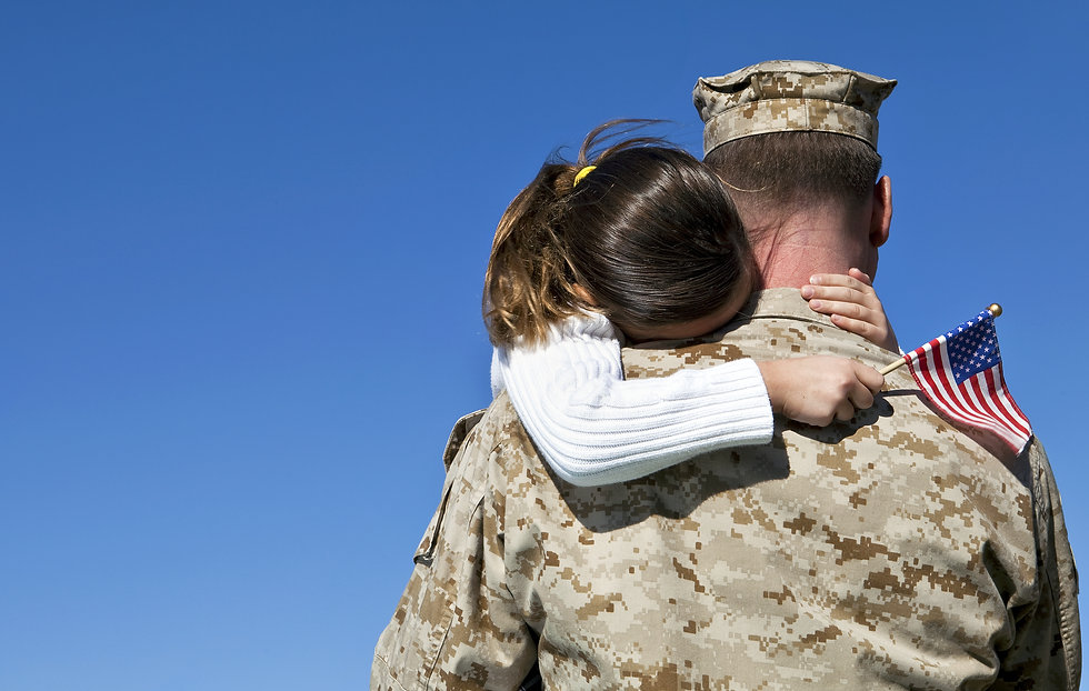 Military Man Hugs Daughter.jpg