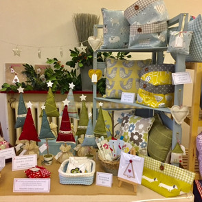 Holmemade Stall - baskets and trees.jpg