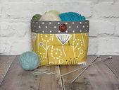 yarn bowl in mustard and grey warm tones