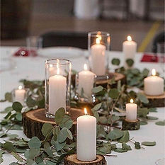 table centerpiece-candles-wood-greenery