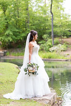Bride over looking lake at Castle McCulloch in Jamestown, NC