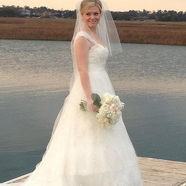 The beautiful bride over the water
