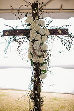 Wooden cross with flowers at Figure 8 in Wilmington, NC