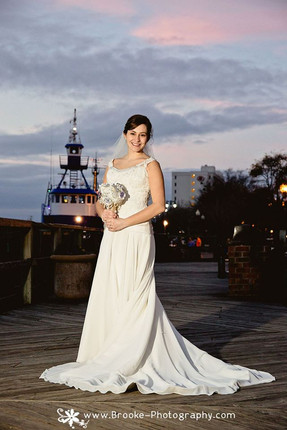 Beautiful bride on the river dock
