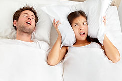 Snoring man. Couple in bed, man snoring and woman can not sleep, covering ears with pillow...n ..jpg