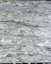 greyish white granite slab being fabricated for countertops