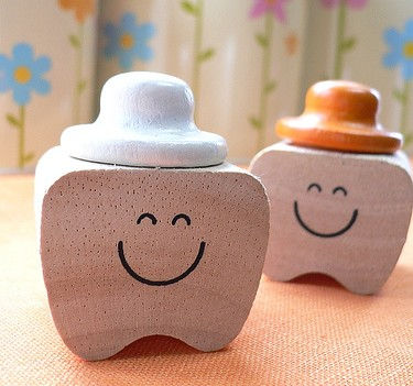 happy smiling teeth with hats as sealant