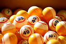 Canva - Many orange and white bingo ball