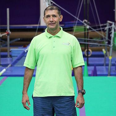 Sunny Gymnastics Coach Oscar Buitrago
