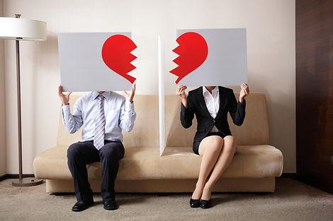 Divorce - Sad young couple holding billb