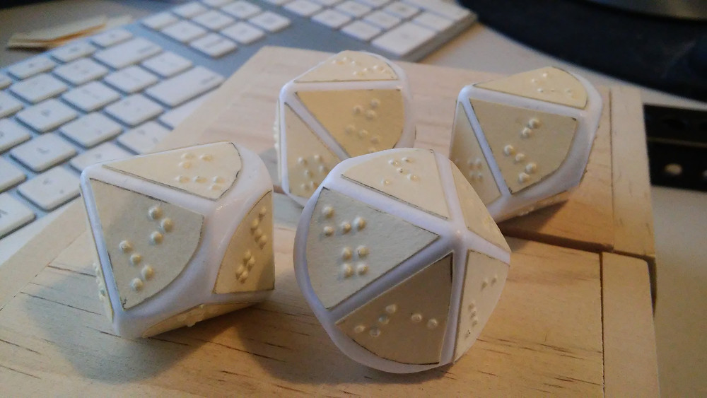 10 sided dice prototype. Braille embossed paper glued to blank dice