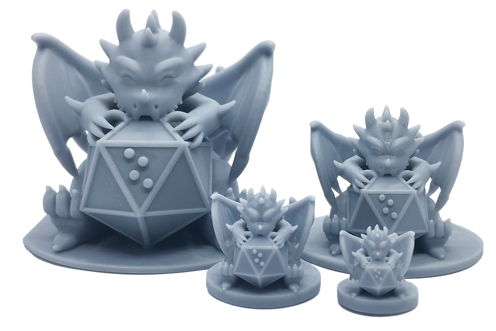 4 gray figurines - 3D printed DOTS Dragon minis in different sizes