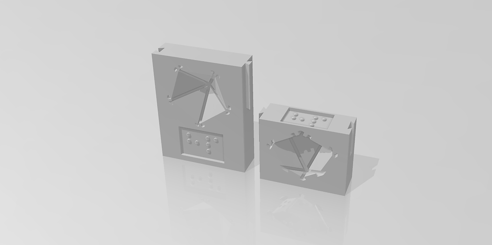 Two trackers - rectangular blocks with a place to hold a d10 and a braille label.