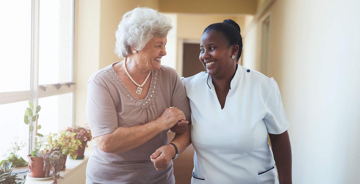 bigstock-Smiling-Home-Caregiver-And-Sen-