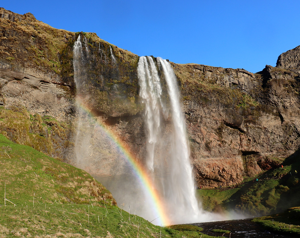 Seljalandsfoss waterfall in Iceland with rainbow