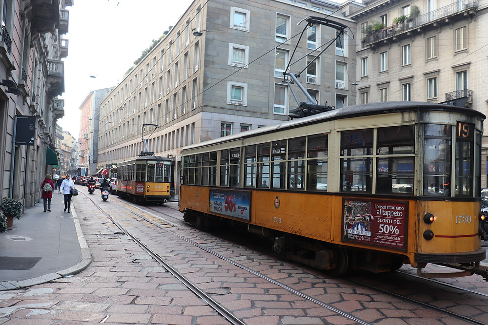 Yellow vintage tram on the streets of Milan Italy