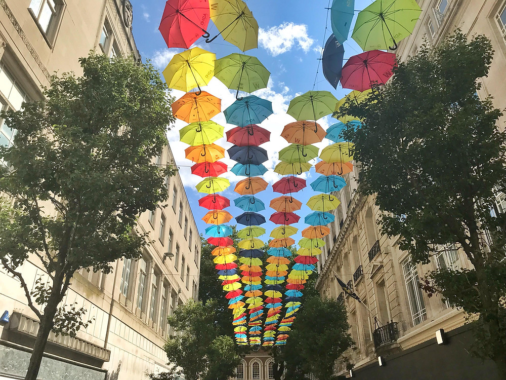 Colourful umbrellas hanging above Church Alley in Liverpool, England