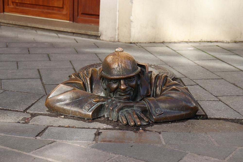 Čumil man at work statue in old town Bratislava Slovakia