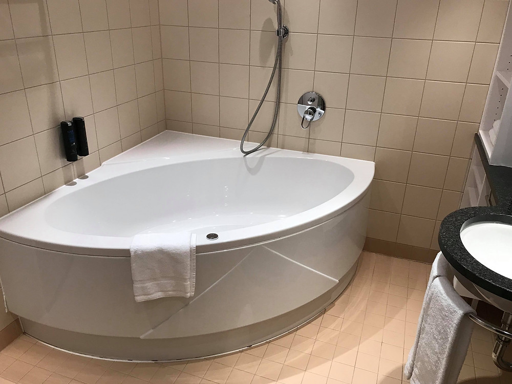 Jacuzzi in the bathroom in premium room in QGreenhotel by Melia Frankfurt, Germany