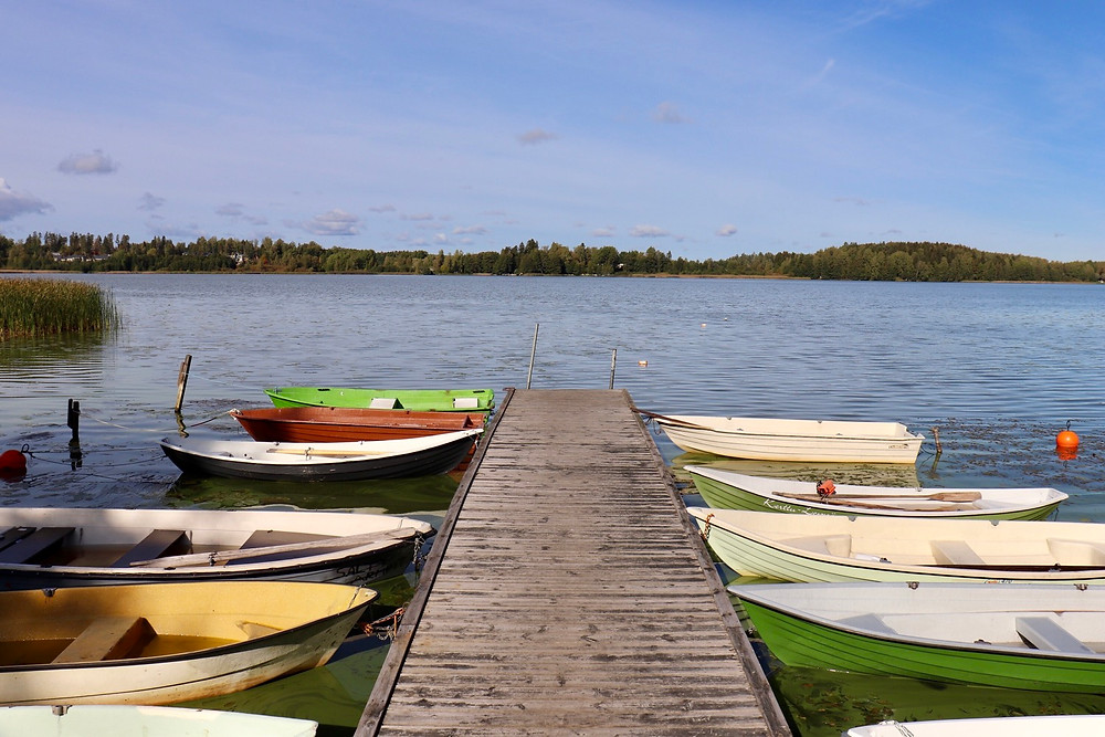 Dock on Lake Tuusula with colourful small boats lined up, Tuusula Finland