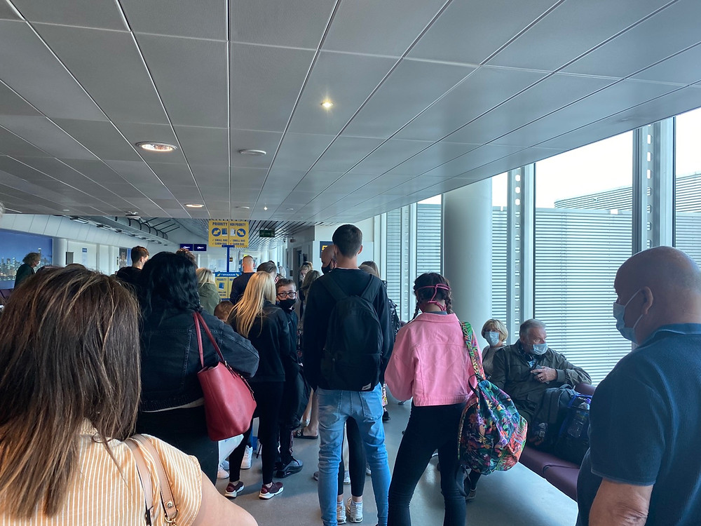 Queue at the boarding gate in Manchester Airport terminal 3