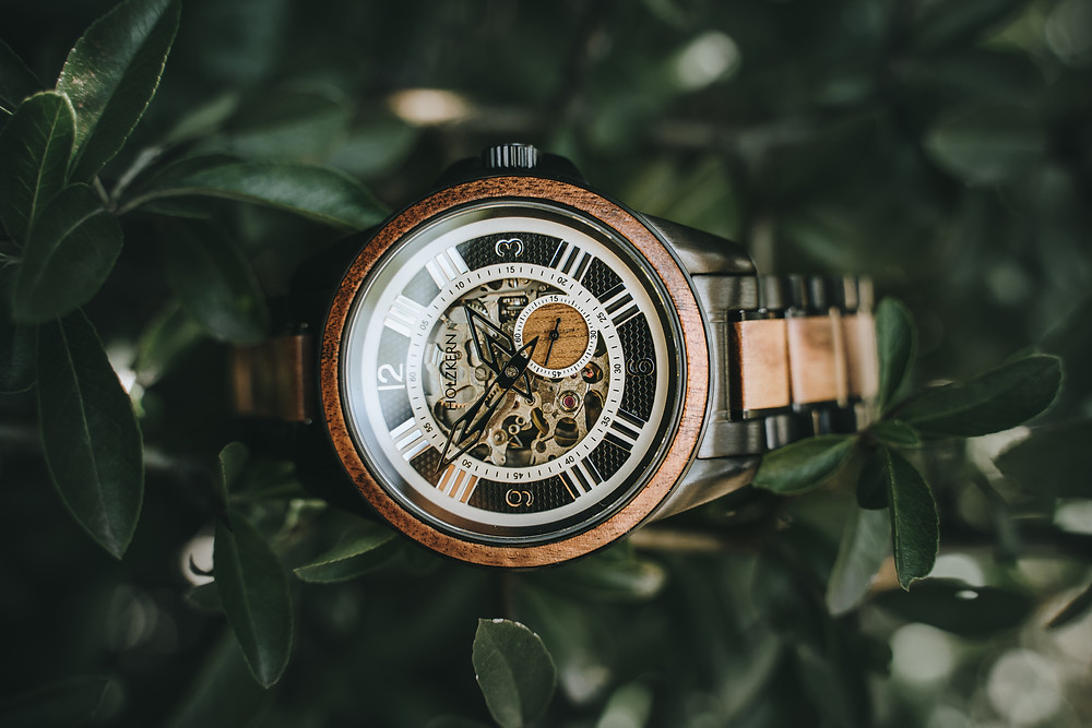 Koa wood men's Genghis watch by Holzkern sitting among the trees
