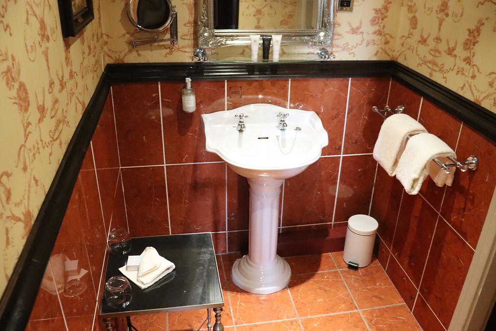 Bathroom inside bedroom in lumley castle hotel northern england