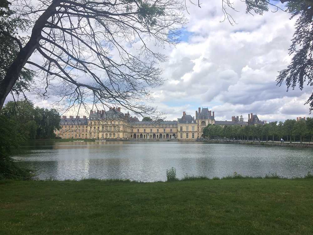 View of Fontainebleau behind Carps Pond in Paris, France