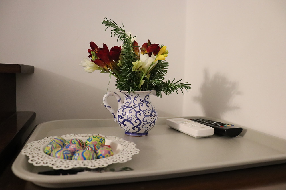 Flowers in a jug and easter chocolates in double bedroom at B&B Baia di Trentova Cilento Italy