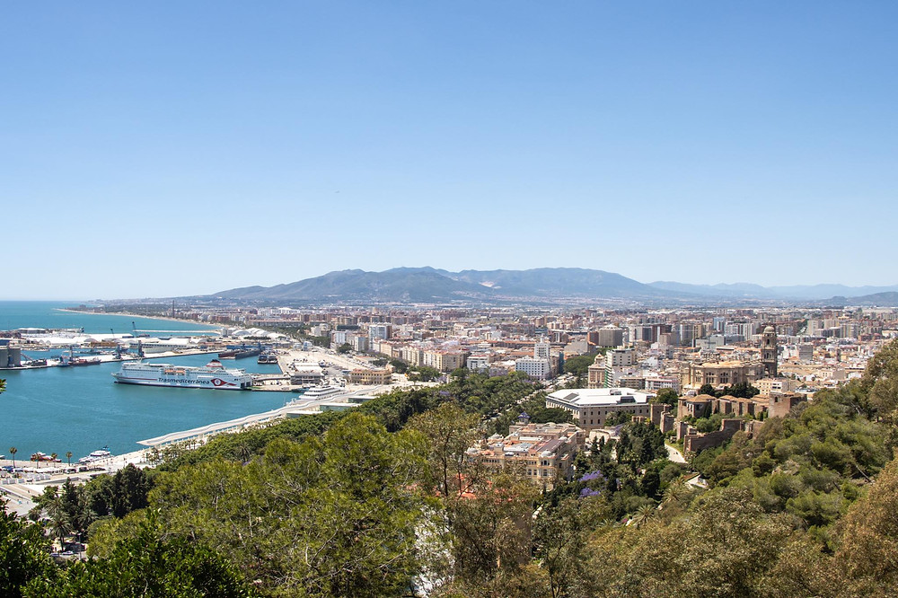 View of Málaga from a viewpoint showing the city and the port/sea area.