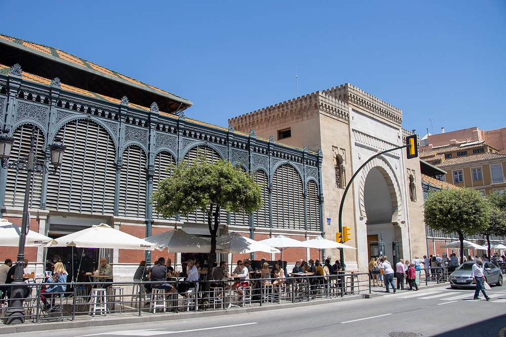 Outside of a large indoor market with an Arab arch.