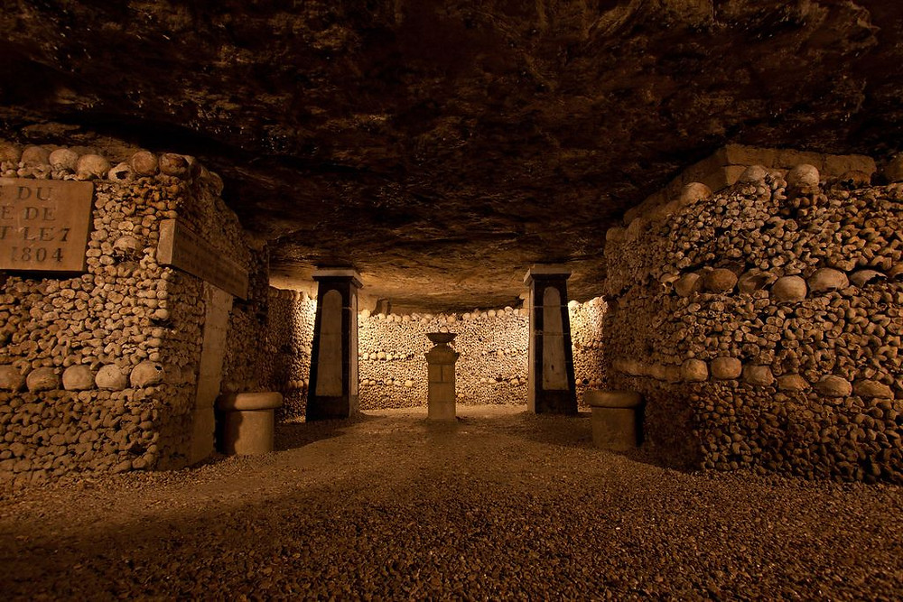 Inside the Paris catacombs showing bones and skulls, France