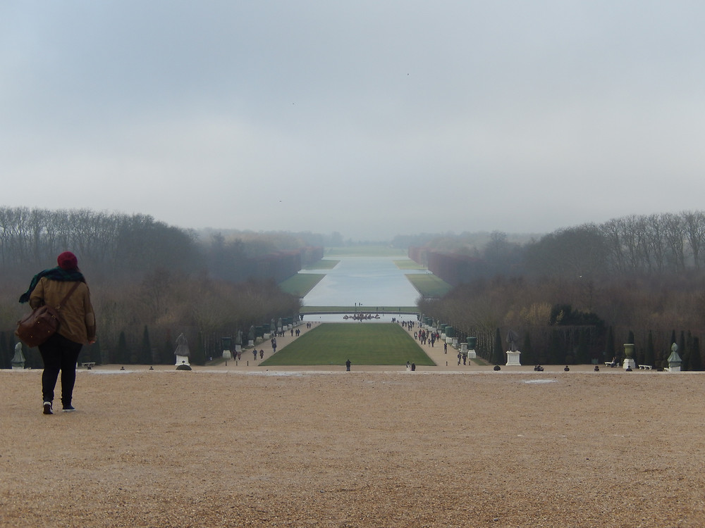 Palace of Versailles gardens in the winter on a foggy day in France