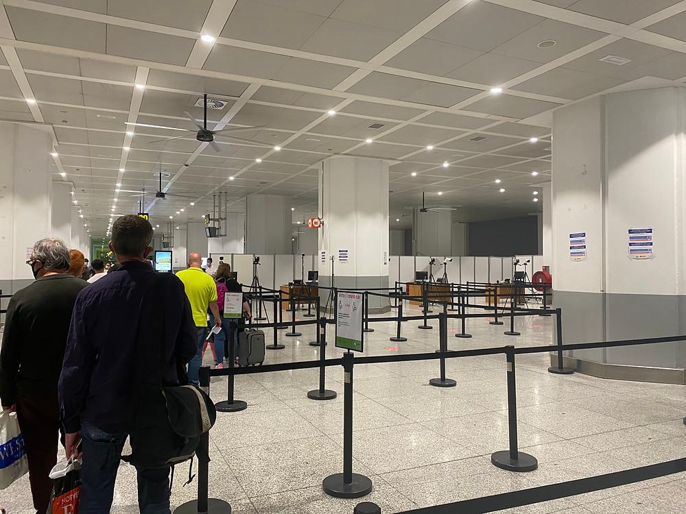Malaga Airport temperature check near luggage area