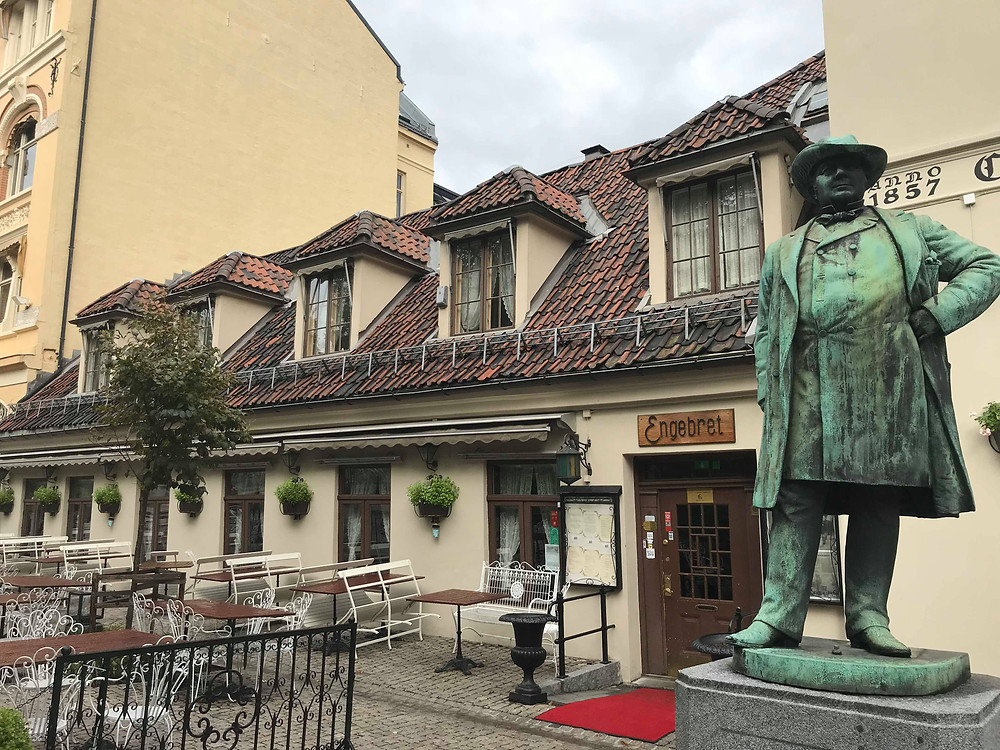 Engebret Cafe with statue from the outside in Oslo, Norway