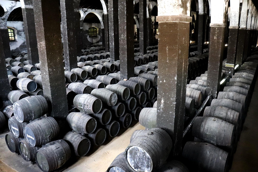 Wine cellar with barrels in the Bodegas Barbadillo in Sanlucar de Barrameda, Cadiz, Spain