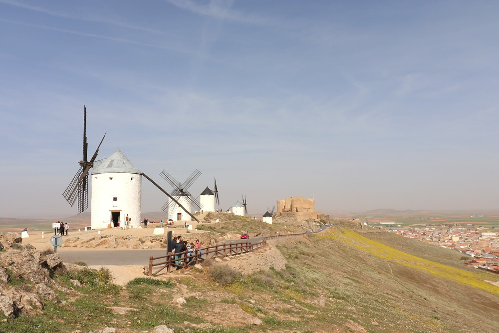 Consuegra windmills in a row overlooking countryside