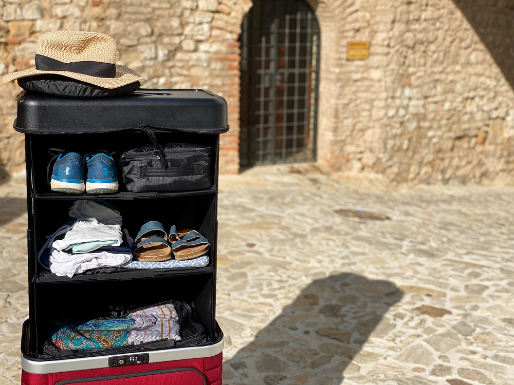 Packing cubes and shoes inside the Pull Up Suitcase in Castillo de Castellar, Spain