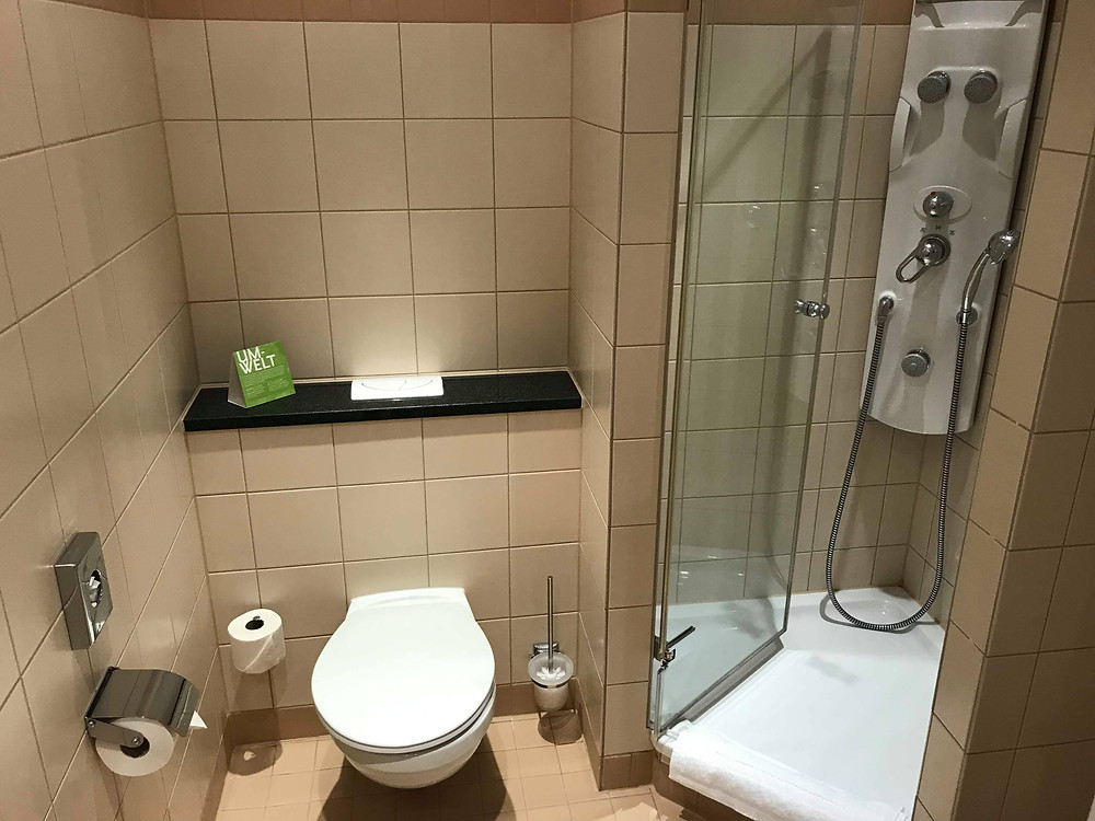 Toilet and power shower in QGreenhotel by Melia Frankfurt, Germany