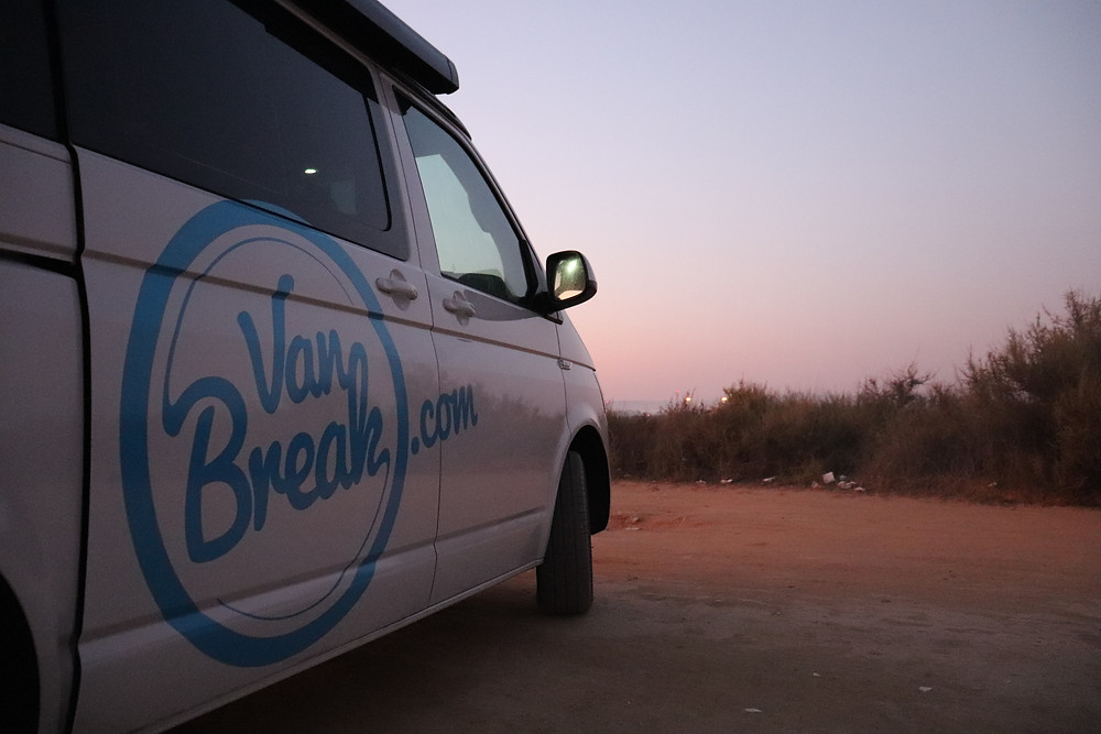 Van parked in a field at sunset in southern spain