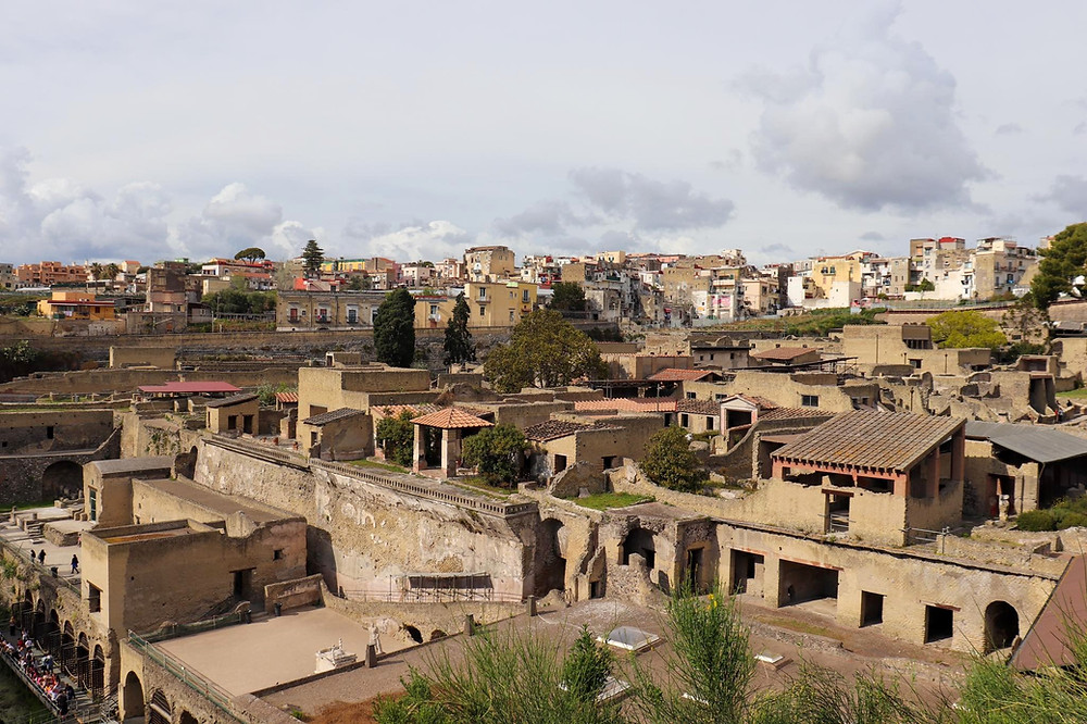 View of the ancient city of Herculaneum from above, showing the roofs of the ruined city.